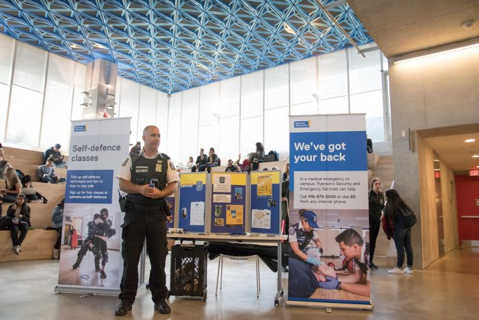Ryerson Security hosting a tabling event in the SLC Amphitheatre