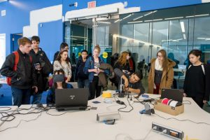 Students gathered watching a demonstration at the DME lab