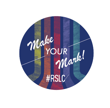 Round dark blue circle with rainbow chalk lines running vertically down the centre, at the forefront there are white words reading: Make Your Mark. Underneath the main words it reads #RSLC